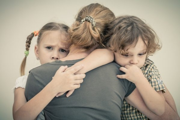 kids-hugging-sad-mother-med